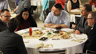 Muslims and Catholics enter into dialogue during a June 28 iftar, a meal after sunset which breaks the Ramadan fast.