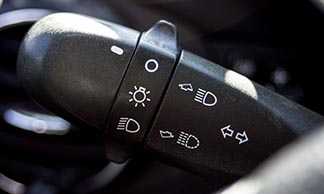 Moving this little lever next to your steering wheel can let people know if you are about to turn your vehicle.