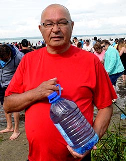 Richard Opikokew of Meadow Lake, Sask., is taking a jug of Lac Ste. Anne water home to share.