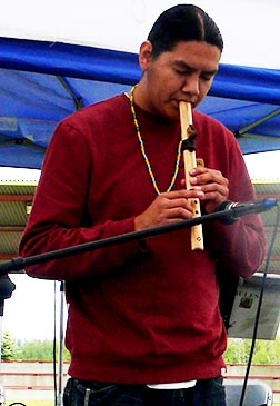 Aboriginal flautist Theodore Waskahat performed two tunes at the July 9 gathering.