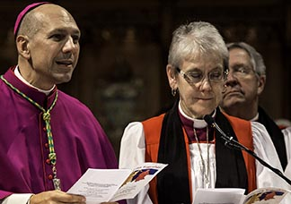 Then-Bishop Donald Bolen and Anglican Bishop Linda Nicholls lead a 2014 prayer service in Toronto marking the 50th anniversary of the Second Vatican Council's Decree on Ecumenism.