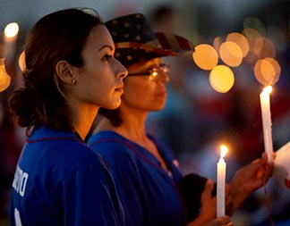 World Youth Day pilgrims hold candles during Eucharistic adoration at the July 30 prayer vigil