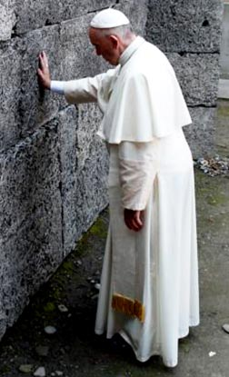 Pope Francis touches the death wall at the Auschwitz Nazi death camp on July 29.